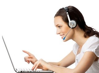 Phone operator in headset with laptop, isolated